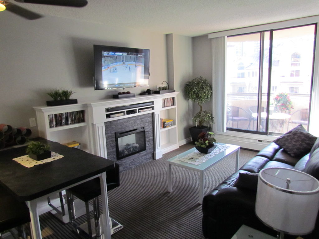 Living Room with 40 Inch TV and Fireplace, Deck Area